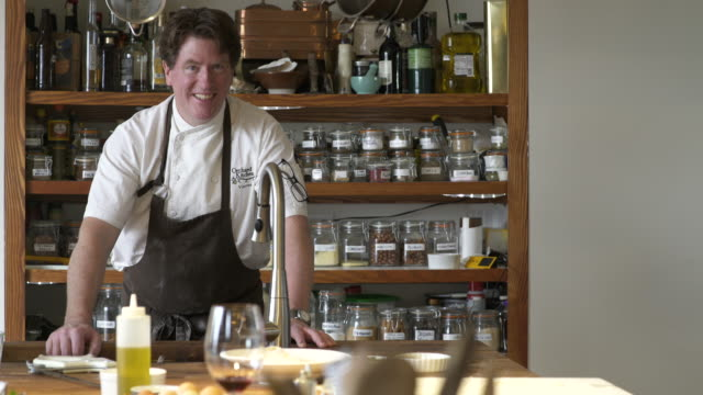 chef looking at camera in a kitchen - whidbey island stock videos and b-roll footage