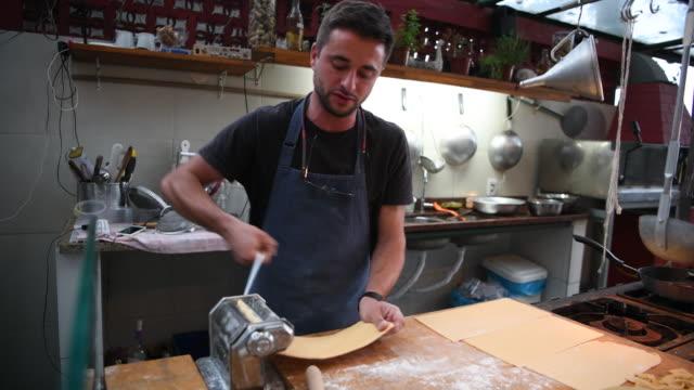 chef making fresh pasta using machine - pasta machine stock videos and b-roll footage