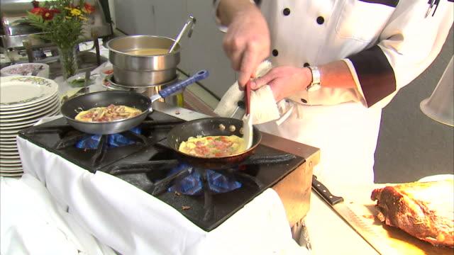 vídeos de stock, filmes e b-roll de ms chef making omelet / orem, utah, usa - orem utah