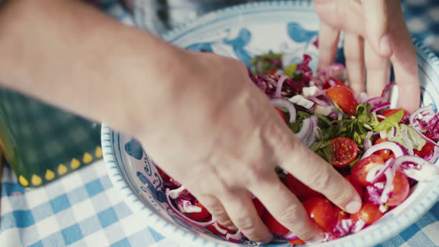 chef mixing salad with hands in bowl - mediterranean culture stock videos & royalty-free footage