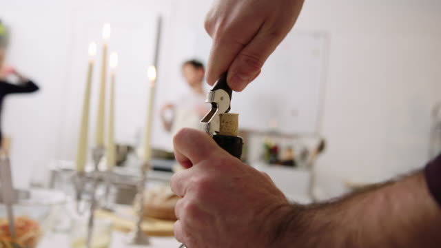 chef opening a bottle of wine - bottle opener stock videos & royalty-free footage