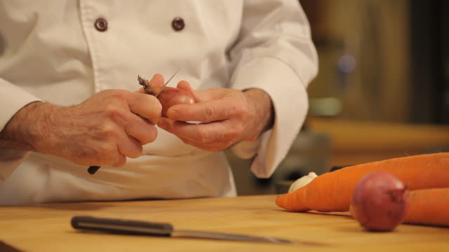 cu of chef pealing shallot with knife - shallot stock videos & royalty-free footage