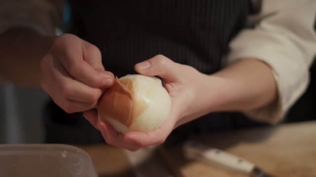 chef peeling onion - onion stock videos & royalty-free footage