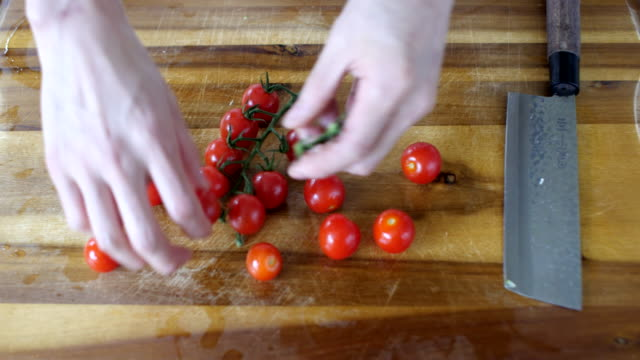 chef picking cherry tomatoes - cherry tomato stock videos & royalty-free footage