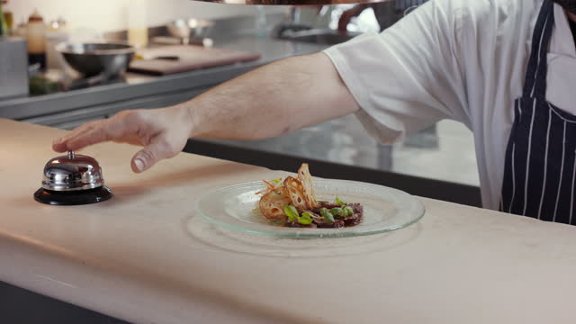 chef placing dish of gourmet food on service counter - food stock videos & royalty-free footage