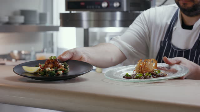 chef placing gourmet food on service counter - kitchen worktop stock videos & royalty-free footage