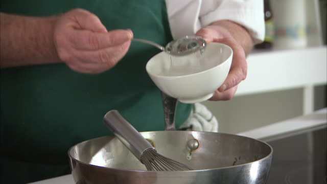 chef pouring in gelatin into a whisking bowl - gelatin stock videos and b-roll footage
