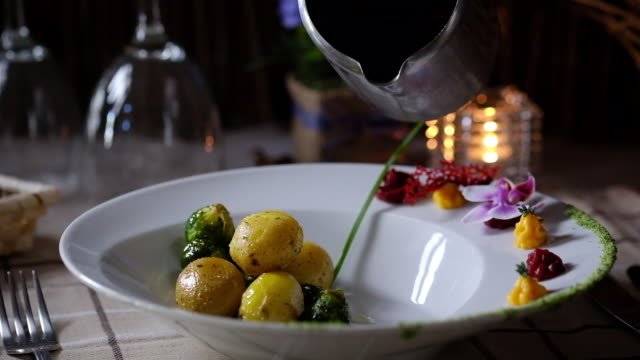 chef pouring sauce in a plate - brussels sprout stock videos & royalty-free footage
