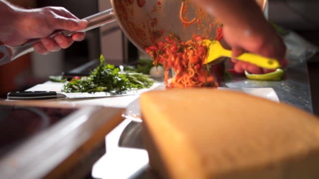 chef pouring spaghetii on plate - apron stock videos & royalty-free footage