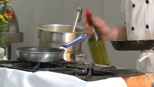 stockvideo's en b-roll-footage met cu chef pouring wine on frying pan / orem, utah, usa - orem utah