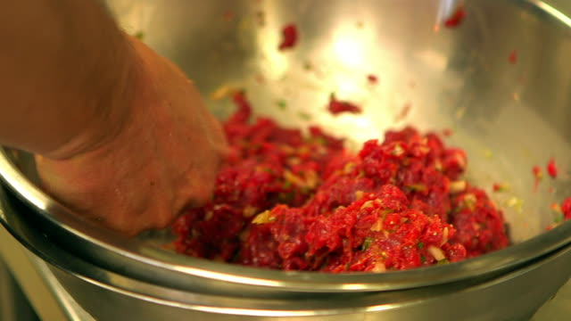 Chef prepares steak tartare