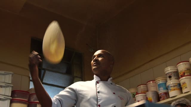 chef preparing a pizza - throwing stock videos & royalty-free footage