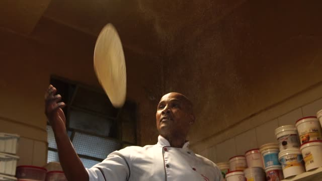 Chef preparing a pizza