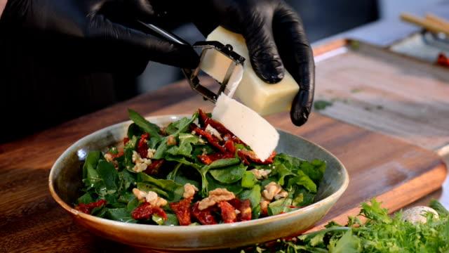 chef preparing arugula salad