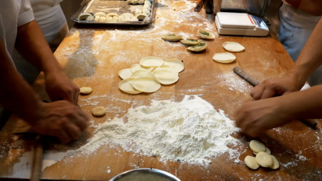 chef preparing dumplings in the kitchen - stuffed stock videos & royalty-free footage