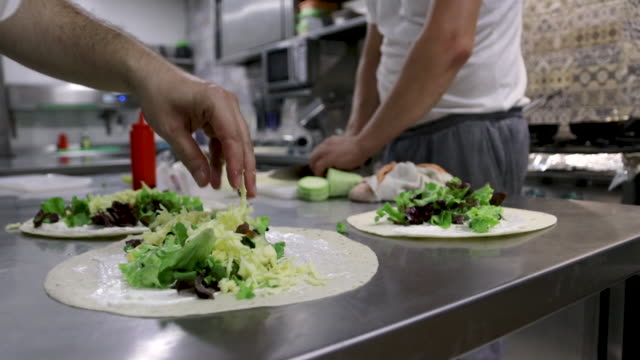 chef preparing food for catering. vegetarian burrito ready to eat - salad dressing stock videos & royalty-free footage
