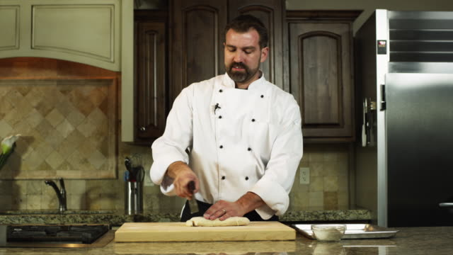 ms chef preparing food in kitchen / orem, utah, usa - orem video stock e b–roll