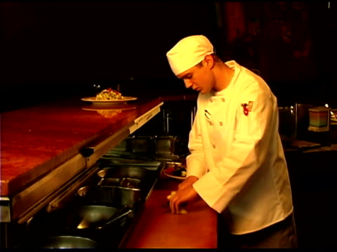 chef preparing food in restaurant kitchen - three quarter length stock videos & royalty-free footage