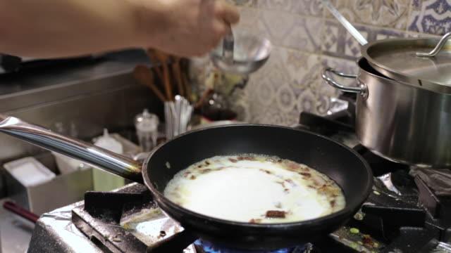 chef preparing meal in restaurant kitchen - linguini stock videos and b-roll footage