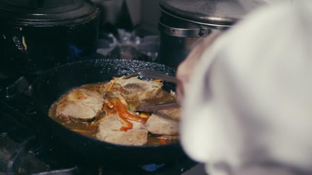 chef preparing pork in an argentinian restaurant kitchen - argentinian culture stock videos & royalty-free footage