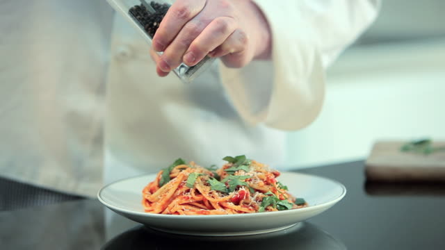 chef preparing spaghetti dish - sprinkles stock videos and b-roll footage