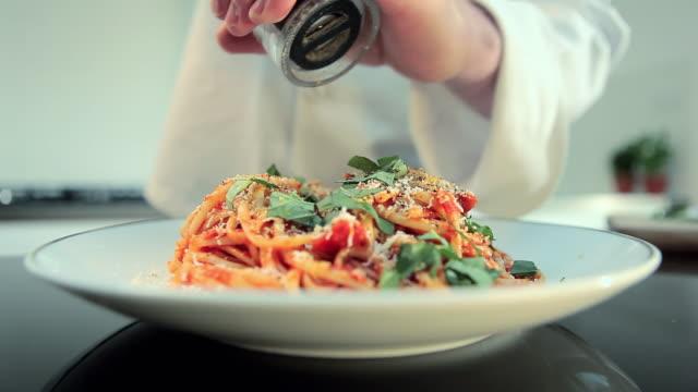 chef preparing spaghetti dish - garnish stock videos & royalty-free footage