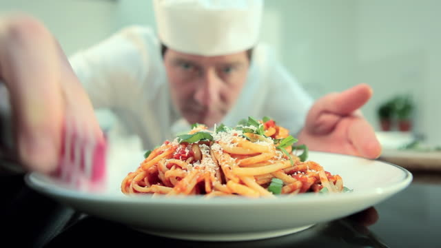 chef preparing spaghetti dish - meal stock videos & royalty-free footage