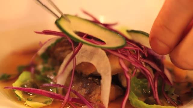 chef put slice of cucumber on mackerel - knob stock videos & royalty-free footage