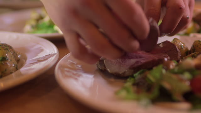 Chef puts tenderloin roast in plates