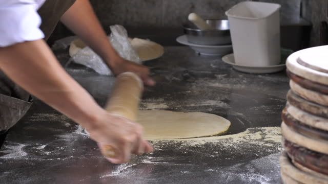 Chef Rolling Dough for Pizza