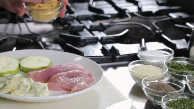 Chef seasoning chicken breasts