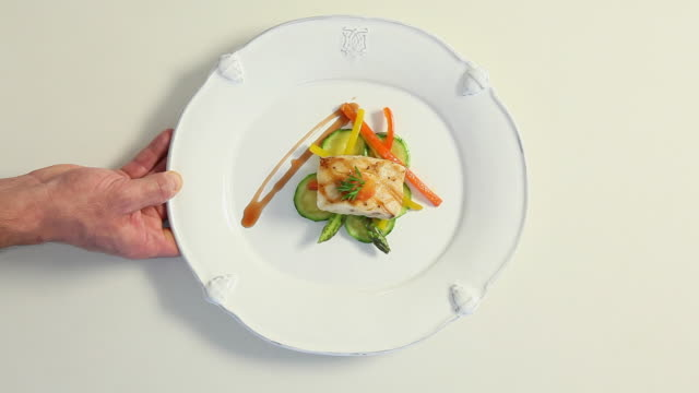 vidéos et rushes de ms chef serving and taking away a fish dish / sao paulo, brazil - assiette