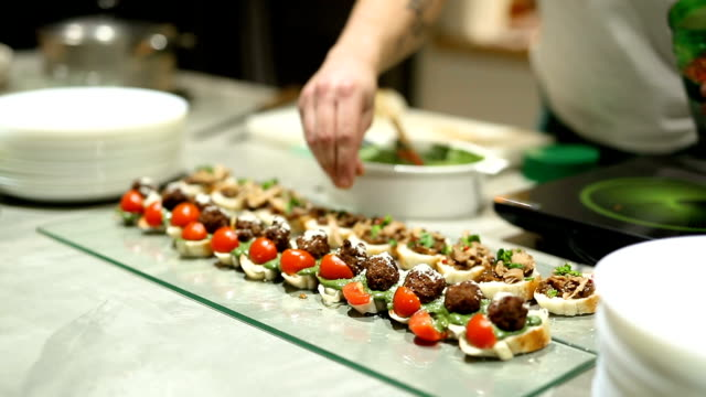 chef serving finger food in restaurant - catering occupation stock videos & royalty-free footage