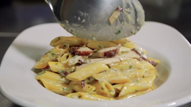 chef serving pasta dish - plate stock videos & royalty-free footage