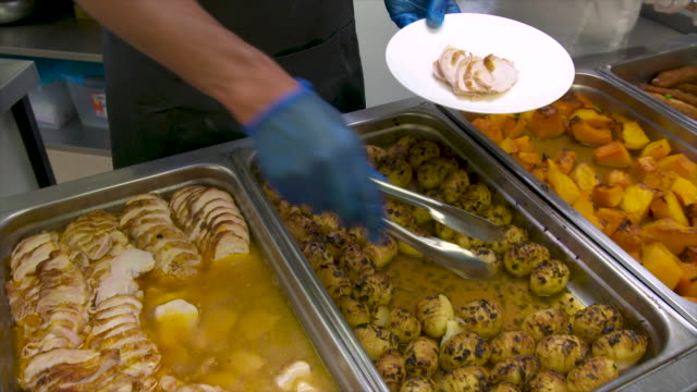 chef serving roast pork and vegetables in a restaurant - school dinner stock videos & royalty-free footage