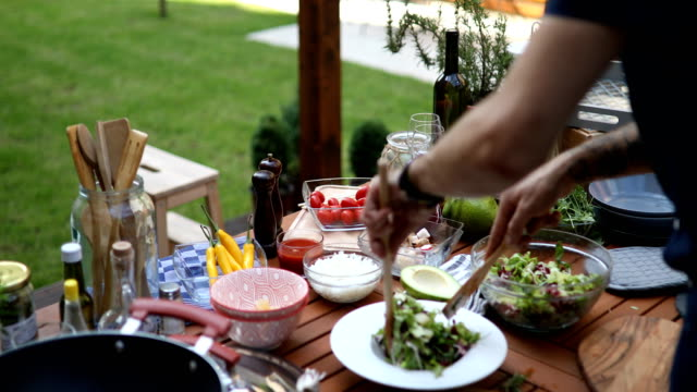 chef serving salad in a plate - cutting stock videos & royalty-free footage