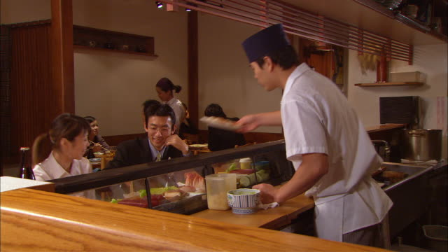 ms, chef serving sushi to clients - sushi stock videos and b-roll footage