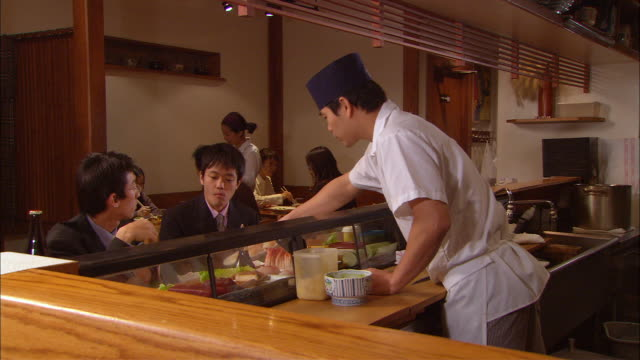 ms, chef serving sushi to clients - sushi video stock e b–roll