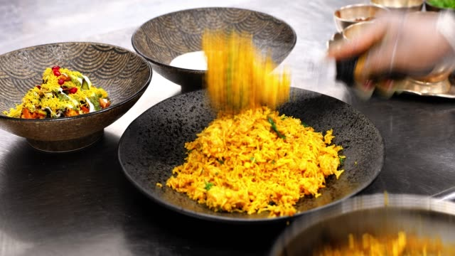 chef serving the biryani along with other condiments at an indian restaurant - silver service stock videos & royalty-free footage