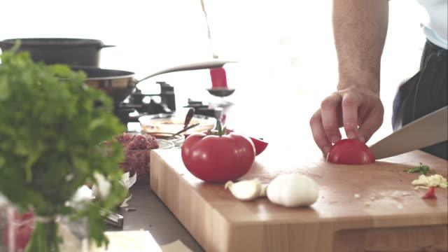 chef slicing and chopping tomatoes on cutting board - kitchen counter stock videos & royalty-free footage