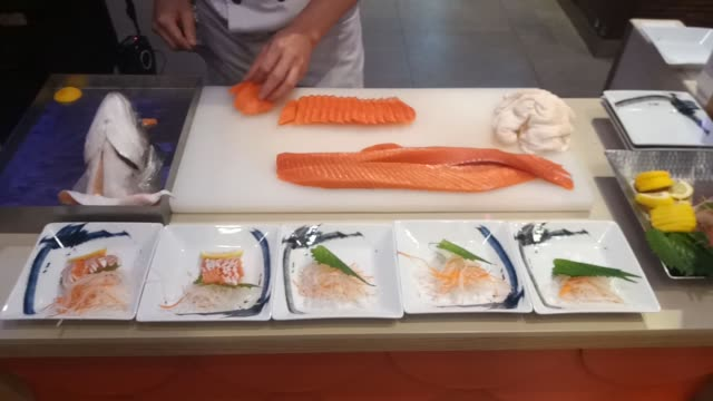 chef slicing and cutting salmon fish for cooking in kitchen - salmon stock videos & royalty-free footage