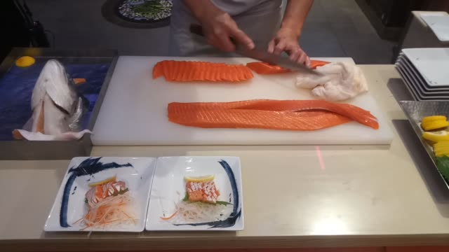 chef slicing and cutting salmon fish for cooking in kitchen - salmon salad stock videos & royalty-free footage