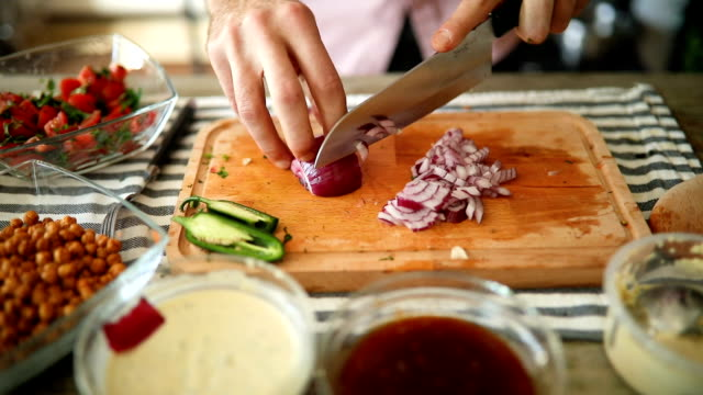chef slicing onion on wooden copping board - rustic stock videos & royalty-free footage