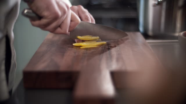 chef slicing peppers in professional kitchen - foodie stock videos and b-roll footage