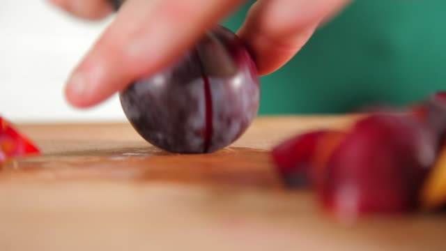 a chef slicing plums - plum stock videos & royalty-free footage