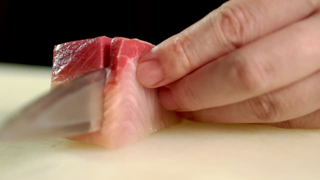 chef slicing some hamachi sashimi in kitchen bar at the japanese restaurant - cutting stock videos & royalty-free footage