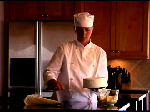 chef spreading icing on cake - icing stock videos and b-roll footage