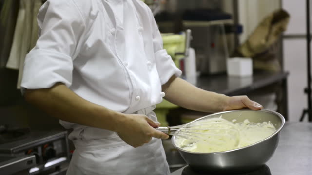 ms chef stirring whipping cream / kyoto, japan - wire whisk stock videos and b-roll footage