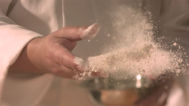 Chef tossing flour.