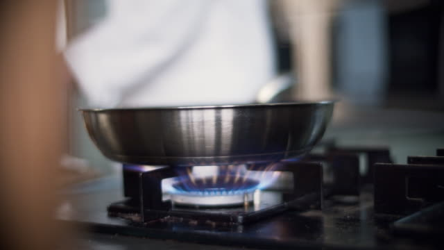 chef tossing food in a pan in professional kitchen - foodie stock videos and b-roll footage